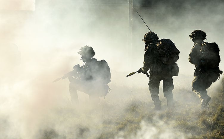 Army procurement - silhouette of soldiers in battle