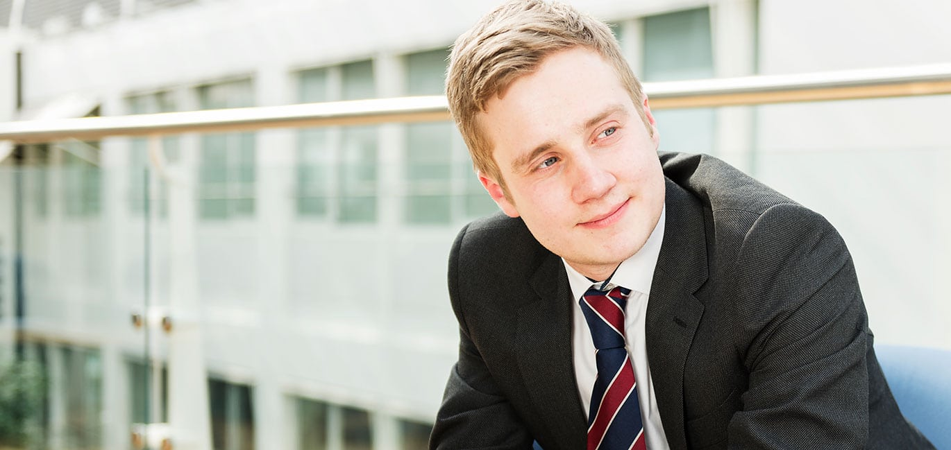 recruitment process - young man in tie smiling
