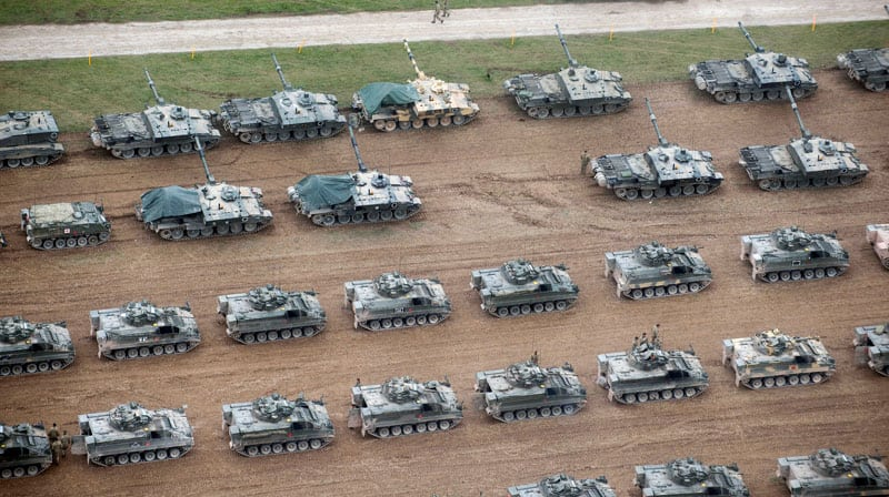 finance image five rows of army vehicles on exercise