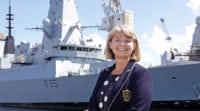 MP Harriett Baldwin stood smiling with Type 45 navy warship