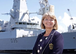 MP Harriett Baldwin stood smiling with Type 45 navy warship