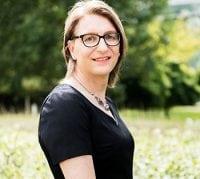 de&s staff member Patricia in black dress smiling