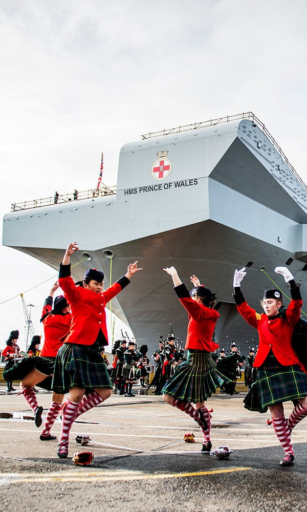 Scottish dancers perform in front of the Prince of Wales carrier