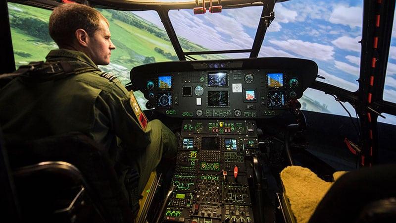 raf pilot in helicopter cockpit