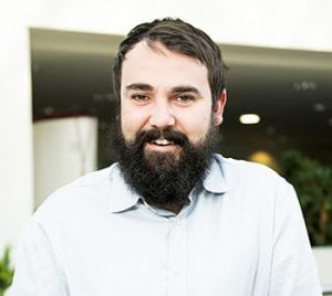 Project Manager with beard smiling