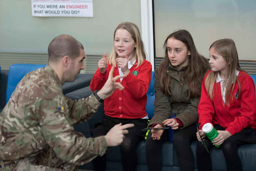 Leaders Award - soldier talking to primary school children about engineering