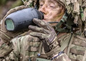 Soldier drinks from water bottle - armed forces water supply contract