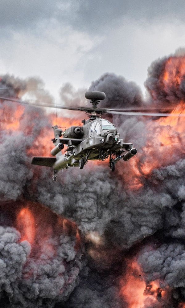 A helicopter flies through an explosion