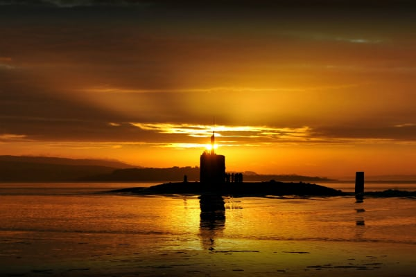 Royal Navy submarine at sunset