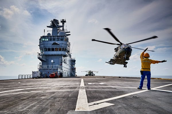 Helicopter takes off from the deck of HMS Queen Elizabeth