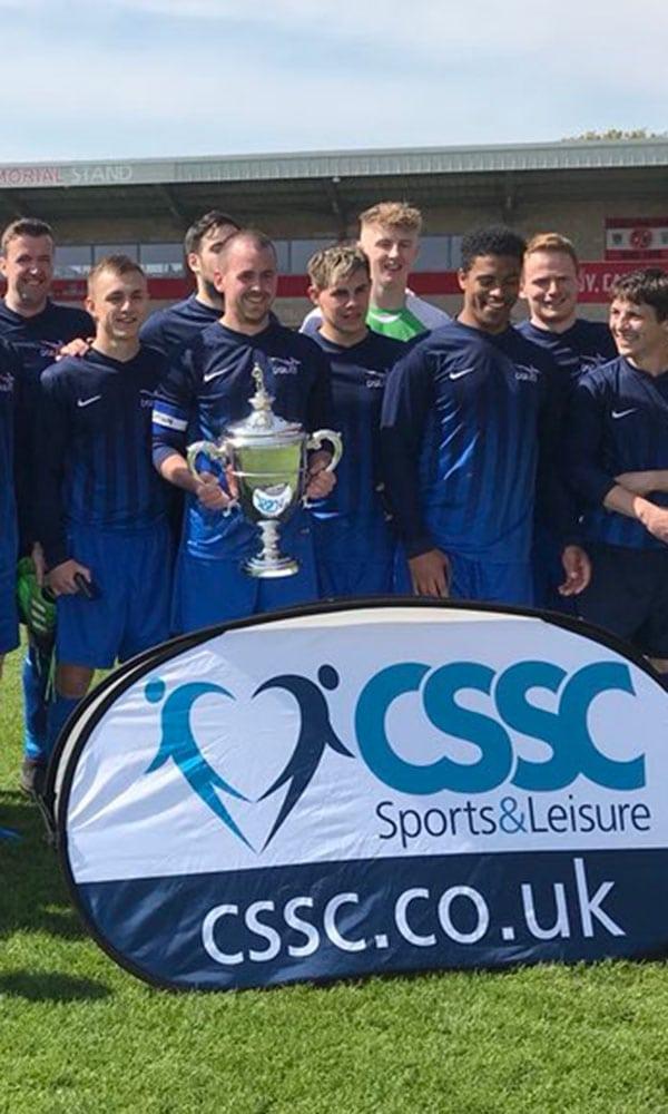 MOD football team lift a trophy
