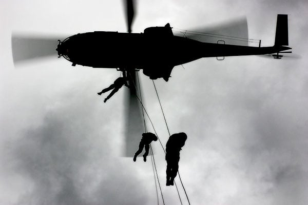 RAF personnel landing from helicopter