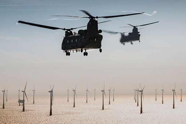 RAF Chinooks flying over wind turbines at sea