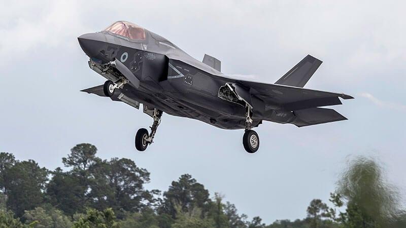 large grey fighter jet lands at RAF Marham