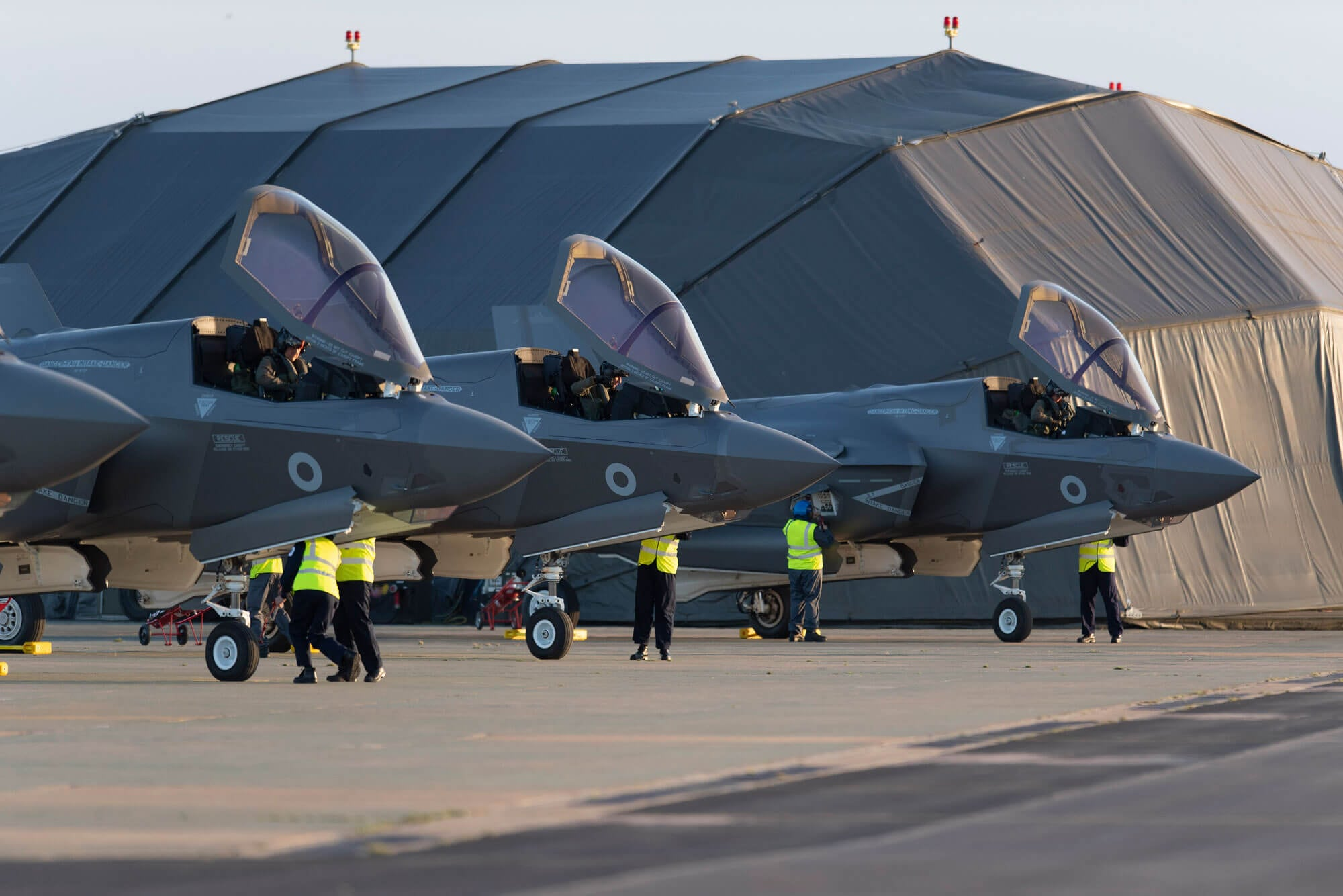 Three F-35s parked in a row