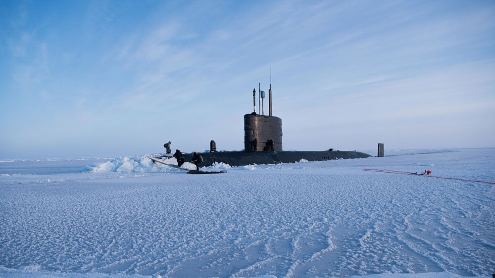 Royal Navy submarine HMS Trenchant after it had broken through the metre-thick ice of the Arctic Ocean to join two US boats on a major exercise.