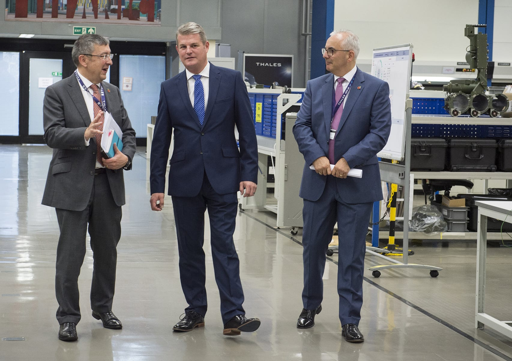 Stuart Andrew MP walking through a factory