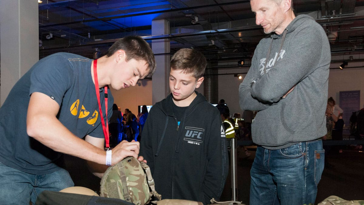 Young boy learns about the science and engineering behind body armour