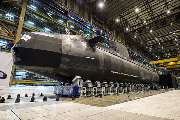 A submarine being built in a large warehouse