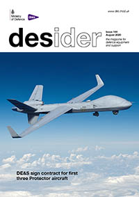 Front cover of the August Desider magazine which shows a grey drone flying above the clouds in a clear blue sky