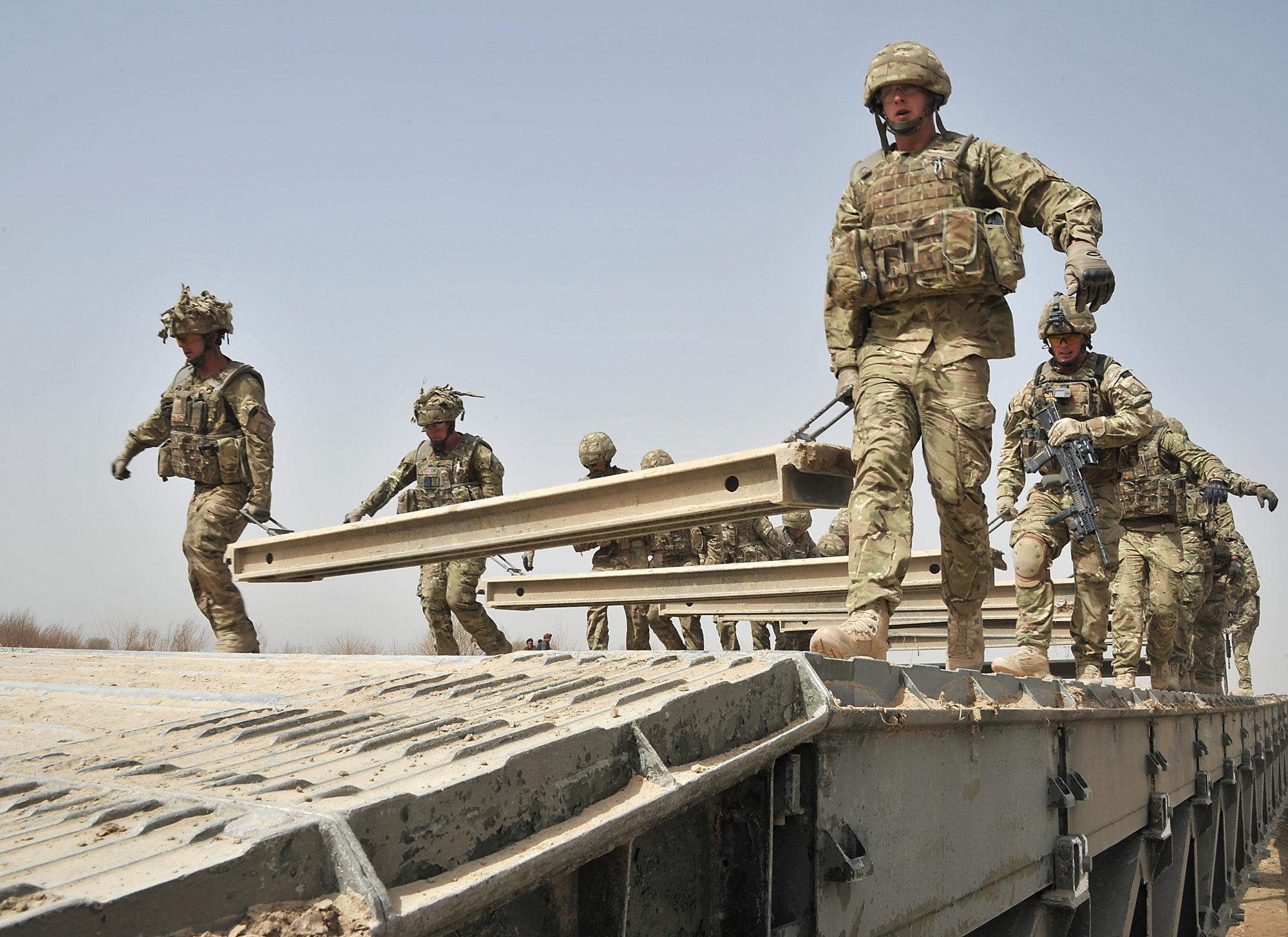 Royal Engineers from 37 Squadron working with a Medium Girder Bridge (MGB) during an operation in Afghanistan. Crown Copyright.
