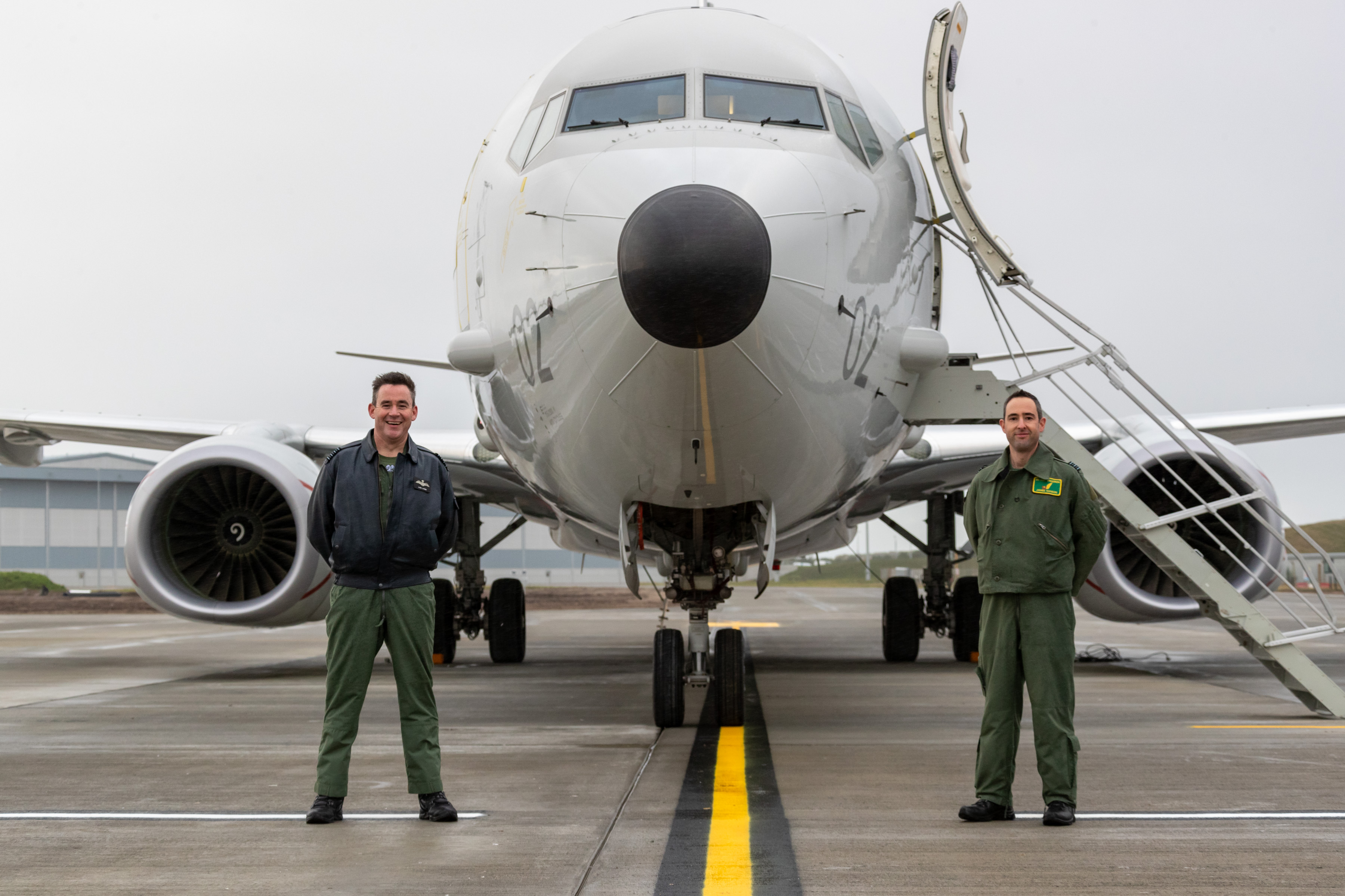 RAF Lossiemouth's Station Commander, Group Captain Chris Layden, stands alongside Officer Commanding 120 Squadron, Wing Commander James Hanson, after they received City of Elgin - the Poseidon aircraft - at Lossiemouth for the first time