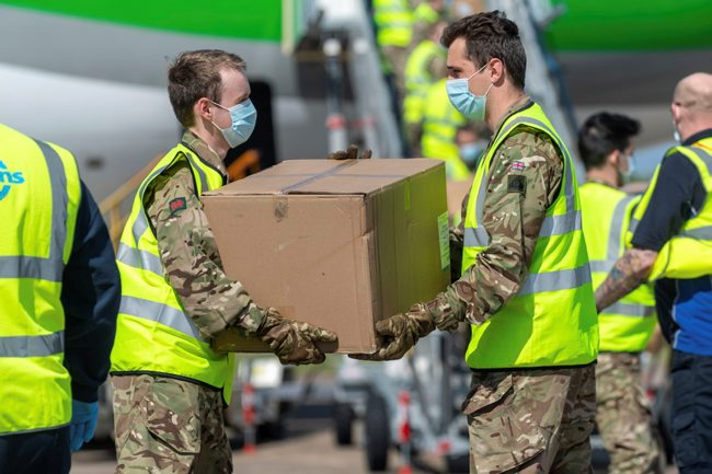 Pic caption: Vital PPE being unloaded from an aircraft in Cardiff Airport by soldiers from 3 Royal Welsh. Pic credit: Cpl Watson P R