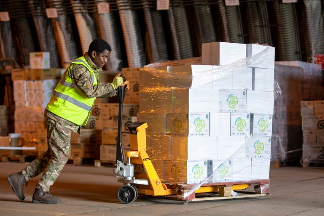 Image shows a member of 4 Regiment, Royal Logistic Corps at work within the National Hub offloading inventory.